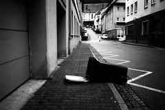 In search (Leica M6) (stefankamert) Tags: street insearch lines trashcan people blur film analog grain city leica m6 leicam6 voigtländer ultron kodak trix noir noiretblanc blackandwhite blackwhite bw wideangle 35mm