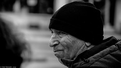 Now that's something special. (Neil. Moralee) Tags: neilmoralee winterneilmoraleeolympus man hat cap wooly cold black white bw bandw mono mature face portrait candid innsbruck austria street old funny stare look olympus omd em5 neil moralee blackandwhite