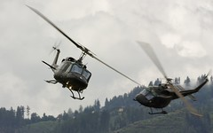 "A pair of Austrian AB-212 ""Twin-Huey"" @ LOXZ (stecker.rene) Tags: bell agustabell twinhuey twintwotwelfe ab212 uh1n austrianairforce bundesheer austrian airforce helicopter heli rotorcraft rotor formation forest hill loxz zeltweg fliegerhorst hinterstoisser airpower airpower2009 airpower09 canon eos450d sigma 150500mm clouds flying aerialdisplay flyingdisplay airshow military transport"