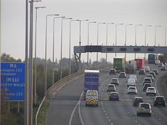 M6(S) Approaching Thelwall Viaduct (J_Piks) Tags: 2018 road motorway m62 lampposts streetlighting streetlights roadsign sign