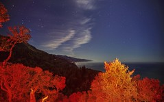 Moonlight view at the California coast (PeterThoeny) Tags: nepenthe restaurant bigsur california usa mountain tree forest red redlight ocean water coast shore sky clear cloud landscape outdoor night sony a6000 selp1650 1xp raw photomatix hdr qualityhdr qualityhdrphotography fav100