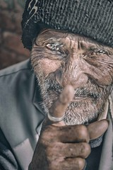 I'm watching you (Roberto Pazzi Photography) Tags: portrait people street eyes travel old man nepal face asia beard kathmandu elderly elder finger culture place photography cap glance hand one person closeup outdoor nikon ring smile