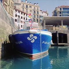 Boat (Vsevolod Vlasenko) Tags: hasselblad spain travel planar planar80mm carlzeiss medium 120 analog fujifilm minoltadimagescanmultipro scan filmnegative eurotrip fishermanboat ocean blue city port