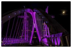 Photo of Salford Quays Lift Bridge lit-up in Purple