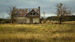 Windows Winking (Mike Schaffner) Tags: abandoned decay decayed derelict deserted dilapidated farm grass home house old ranch ruins windmill oncewashome