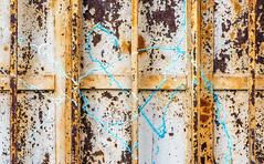 Making A Mark (jaxxon) Tags: 2018 d610 nikond610 jaxxon jacksoncarson nikon nikkor lens nikon105mmf28gvrmicro nikkor105mmf28gvrmicro 105mmf28gvrmicro 105mmf28 105mm macro micro prime fixed pro abstract abstraction metal peelingpaint cracked crackleur rusty crusty urban bars security decay decaying rusting surface texture