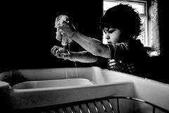 playing with the soap (Mallybee) Tags: fuji fujifilm xa1 beyer bw blackwhite boy playing soap water dramatic effect mallybee 1855mm f284 fujinon ois portrait