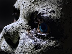 Had better days (Wayward Eye) Tags: old disturbing sony macro blueeyes cracking decrepit lowkey creepy doll