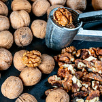 Walnuts, peeled and in a shell with Nutcracker thumbnail