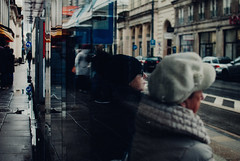The Curious Life of Lady Hellawes. (ewitsoe) Tags: autumn street warszawa winter erikwitsoe erikwitsoecom holidays poland warsaw ladies waiting tram stop station transit pedestrian mood women sitting reflection urban cityscape