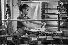 Making Pretzels (tim.perdue) Tags: north market columbus ohio downtown urban city short arena district candid street black white bw monochrome nikon d5600 nikkor 18140mm making pretzels bakery brezel woman girl person figure bowl sign free sample