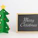 Merry Christmas text with Christmas tree