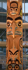 VERY BEAUTIFUL LARGE  WESTCOAST TOTEMS.  THESE WERE NEW ADDITIONS TO THE VANCOUVER AIRPORT. BC. (vermillion$baby) Tags: nativeart airlines airport art carvng color firstnations fliclr haida red totem vancouver westcoast wood artsculpture native pacificnorthwest artofnorthamerica artofnativenorthamerica museum carving sculpture woodcarving museums artofthenative nativeamerican indian gallery vivid aborigine