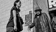Meeting point! (Baz 120) Tags: candid candidstreet candidportrait city contrast street streetphotography streetphoto streetportrait strangers sony a7 rome roma europe women monochrome monotone mono noiretblanc bw blackandwhite urban life portrait people italy italia grittystreetphotography faces decisivemoment