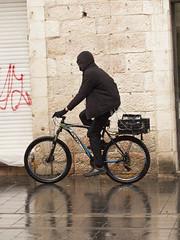 Bicyclist in the Rain (zeevveez) Tags: זאבברקן zeevveez zeevbarkan canon people rain jaffastreet