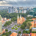 Ho Chi Minh City, Vietnam - October 2nd, 2016: Notre Dame cathedral  Beauty buildings over a hundred years old, so far is high buildings for  Economic Development in Ho Chi Minh City, Vietnam