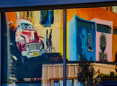 Reflecting Cuba (Steve Taylor (Photography)) Tags: cuba hat cabin venetianblind blind graffiti mural streetart hut window colourful cool people newzealand nz southisland canterbury christchurch cbd city tree distorted car bike bicycle cycle rider woman lady portrait reflection stripes lines automobile