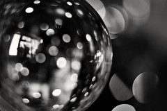 Holiday Bokeh (Steve.T.) Tags: macromonday blackandwhite bokeh holidaybokeh orb glassball nikon d7200 f18 50mm 50mmlens macromondays abstract