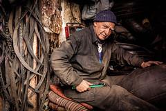 Recycling Tires. (Robert Mehlan - Munich) Tags: canon5dmkii friendly man streetphotography robertmehlan marocco oldmanworking marrakesh