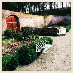 Winter in the Walled Garden (Julie (thanks for 8 million views)) Tags: 2019onephotoeachday colcloughwalledgarden bench benches wall fence fences door trees wexford ireland irish hipstamaticapp iphonese squareformat outdoor path flowerbeds 100xthe2019edition 100x2019 image11100 hww