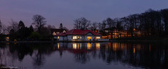 boathouse night scene (Rourkeor) Tags: 35mm 35mmzeisssonnartlens carlzeiss eastrenfrewshire rx1r roukenglenpond scotland sony uk boathouse colourful fullframe lightshadows lights nightshot pond reflections trees water winter sonyflickraward