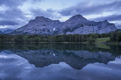 Wedge Pond, blue hour (birgitmischewski) Tags: bluehour wedgepond alberta reflection mountain lake morning canada water