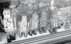 Robots for Sale (Bill Smith1) Tags: believeinfilm billsmithsphotography hc110b65min20c heyfsc kodaktrix400 nikkorai50f2lens nikonfm toronto