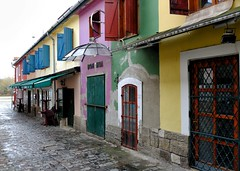 BOH-MIA (halifaxlight (mostly off in July)) Tags: hungary szentendre riverdanube street shops cafes windows doors shutters cobblestones canopies colourful rainy