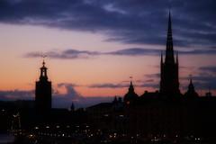 Soft Skyline (*Kicki*) Tags: stockholm gamlastan sweden oldtown fotofikapromenad autumn skyline cityscape silhouettes sunset sky dusk soft orton stadshuset cityhall city church riddarholmskyrkan evening trekronor pink purple lights