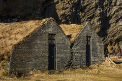 Concrete Barns of Drangshlíð 2 in Iceland (Lee Rentz) Tags: drangshlíð2 drangurinnrock eyjafjöllmountains iceland icelandic katlageopark mounthrútafell ringroad route1 southcoast adventure agricultural architecture barn barns boulder cliff concrete elf elfhouse elves experience farm farmingagriculture folklore grasses hometoelves horizontal house landscape legend legendary legends march nature old outdoors pouredconcrete rock rocks roof sod stone structure tourism tradition traditional travel turf winter