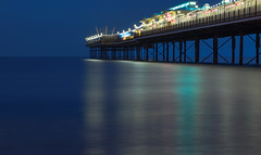 Paignton Pier evening lights (Vigor11) Tags: cloudy evening sea ocean longexposure bluehour blue lights pier jetty red orange yellow reflections landscape water sky bay