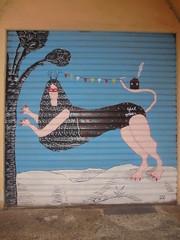 girl power (en-ri) Tags: kiki skipi ragazza girl nero bianco azzurro cielo sky bologna wall muro graffiti writing claws artigli rosa casa home albero tree