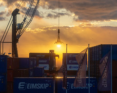 The Crane and the Rising Sun at the Eimskip Container Terminal (Corey Templeton) Tags: boat city eimskip industrial maine newengland portland portlandmaine sun sunrise wharf winter unitedstatesofamerica us