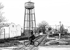 High Contrast (Kool Cats Photography over 11 Million Views) Tags: travel tracks highcontrast blackandwhite bw monochrome watertower bicycle traveloklahoma oklahoma oklahomacity outdoor photography architecture artistic abandoned streetphotography