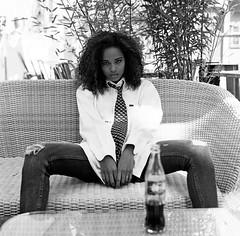 Comme un garçon III (lizardking_cda) Tags: hasselblad medium moyen format film analog ilford delta400professionaldp400 portrait model shooting photoshoot beautiful belle woman femme fille girl nice lecannet france côte azur riviera eoshe chercherlafemme fashion sexy jambes legs jean androgyne androgynous tomboy boyish cravate domination tie badass hot chaud spring printemps sun soleil curly hair brazilian african black nb bw coke cocacola glamour brazil village bar riot attitude argentique filmisnotdead ishootfilm white métisse mixed dof moods vintage