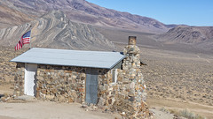 Geologist Cabin (magnetic_red) Tags: cabin stone remote view vista deathvalley landscape trail flag americanwest