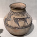 Buff ware jar with painted ibexes