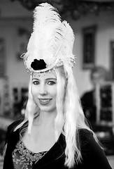 Feathered Hat (wyojones) Tags: texas galveston dickensonthestrand holidayfestival hat dress blonde hair girl lady lovely woman beautiful beauty feathers smile pretty curls jacket plumes blueeyes wyojones