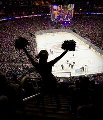 The Cheerleader (evanffitzer) Tags: iphone7 lasvegas vegas hockey ice arena skaters cheerleader pompoms cheer crowd stadium yay go teams view clock jumbotron faceoff