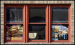 We deliver! (alamond) Tags: window backside street foof delivery glass reflection canon 40d tamron 18270 austin texas usa squares red brane zalar alamond