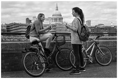Bikes & Bananas (Silver Machine) Tags: streetphotography street candid girls bikes bicycles bananas eating talking standing london southbank fujifilm fujifilmxt10 fujinonxf35mmf2rwr