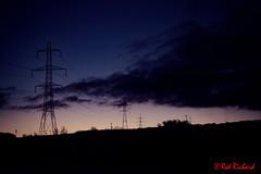 Ohm unit of resistance 2 (red.richard) Tags: pylons electricity sunrise sun clouds blue silhouette black