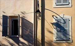 Just one more shadow-and-shutter pic... (hogsvilleBrit) Tags: antibes shadow shutter lamp streetlamp symmetry window france cotedazur pipe