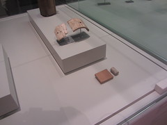 A seal and other fragments.  CaixaForum, Madrid, June 2018 (d.kevan) Tags: exhibitions caixaforum ancientinstruments displaycabinets june2018 madrid spain exhibits seals fragments