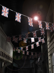 The British Ironmonger (Steve Taylor (Photography)) Tags: unionjack bunting facade flag replica museum looking up newzealand nz southisland canterbury christchurch lensflare perspective