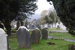 Glendalough, Wicklow Mountains (MargrietPurmerend) Tags: tombstones graves medieval cemetary ierland ireland roundtower wicklowmountains glendalough