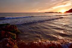 Sundown on Arillas beach. (rustyruth1959) Tags: sunlight light sky outdoor shore seaside coast beach surf ripples glow hill headland seaweed rocks horizon waves ioniansea sea sunset sundown arillasbeach arillas corfu greece europe tamron16300mm nikond5600 nikon alamy top20greece