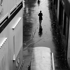 In the street below (pascalcolin1) Tags: paris13 femme woman pluie rain reflets reflection enbas below photoderue streetview urbanarte noiretblanc blackandwhite photopascalcolin 50mm canon50mm canon