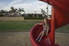 Slide Pose (evaxebra) Tags: luna slide pose red park playground grass tagyourrags