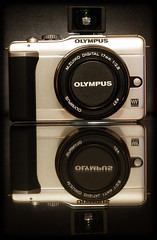 Olympus E-PL1. . . (CWhatPhotos) Tags: cwhatphotos photographs photograph pics pictures pic picture image images foto fotos photography artistic that have which contain olympus epl1 pen original colors colours black white silver bodycap lens body three together red camera view finder add vf1 one viewfinder zuiko 17mm prime